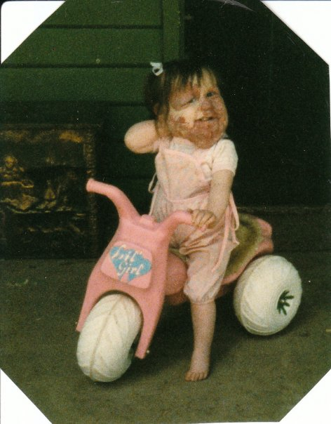 Even as a toddler, I rocked a pink bike!